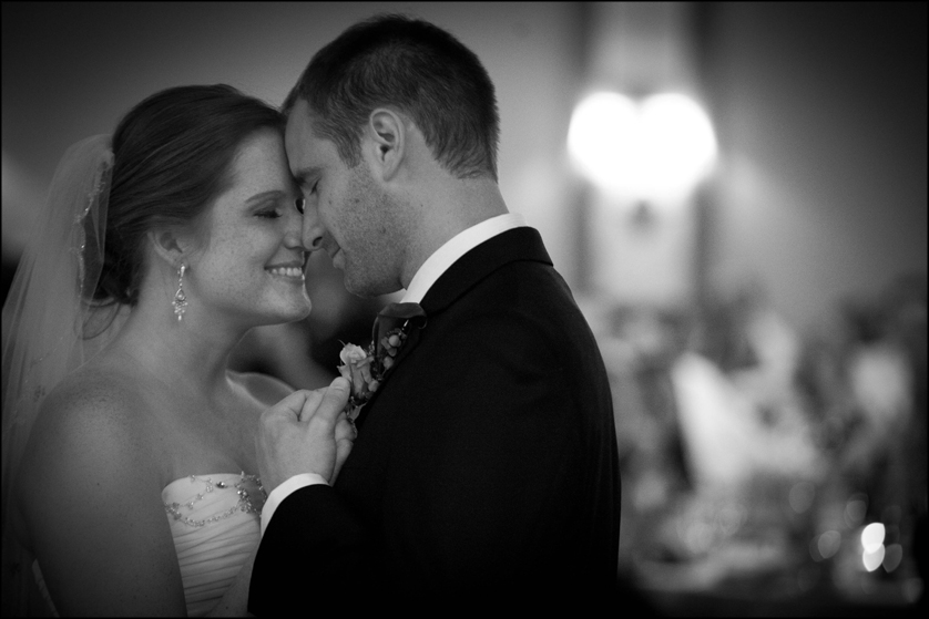black and white candid photo of bride and groom