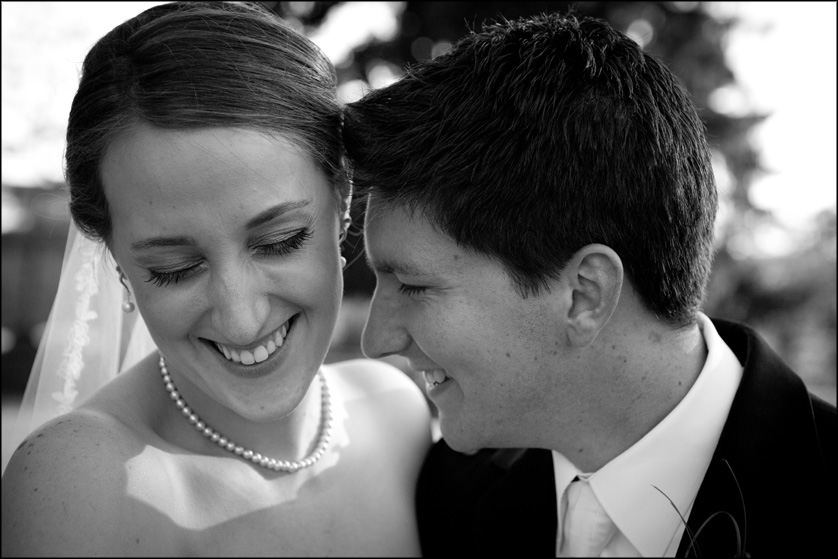 Black and white portrait of smiling married couple at Muhlenberg College in Allentown, PA
