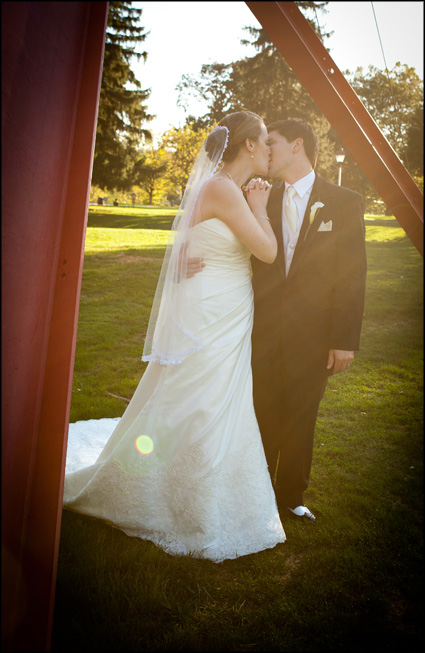 Couple kisses after marrying in the Chapel at Muhlenberg College