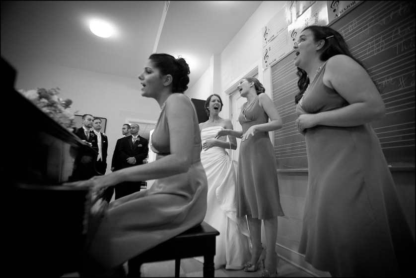 bridesmaids sing and play piano after wedding ceremony at Presbyterian Church of Chestnut Hill