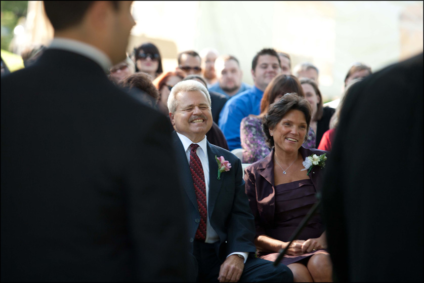 Parents laugh during a beautiful fall wedding ceremony