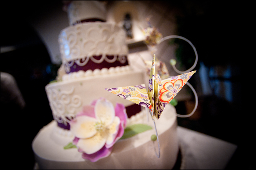 cake with purple details and paper crane