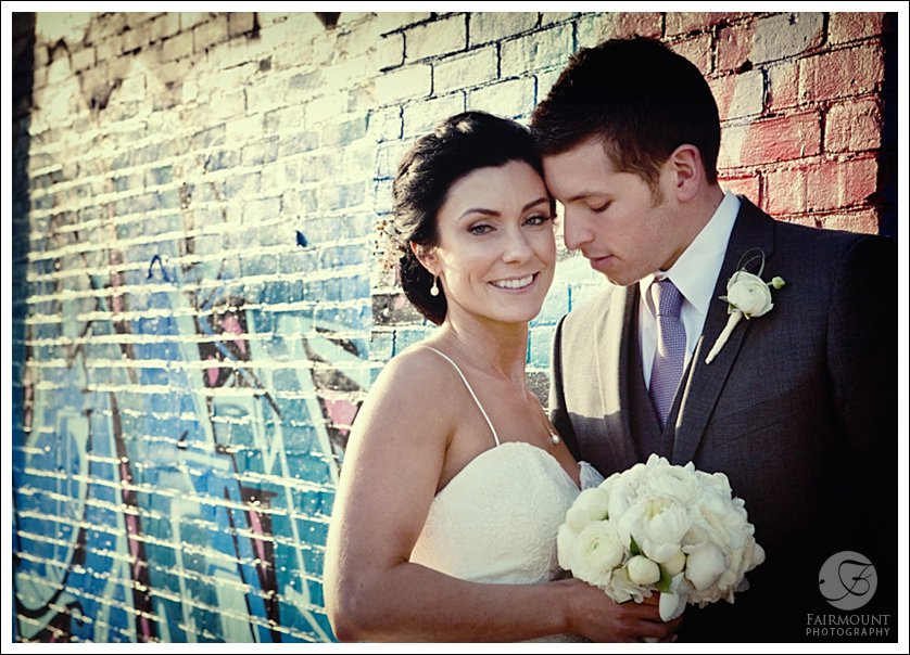 Bride and Groom by brick wall
