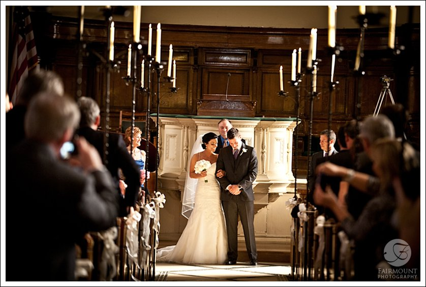 Bride and Groom in historic Philadelphia church with candelabras