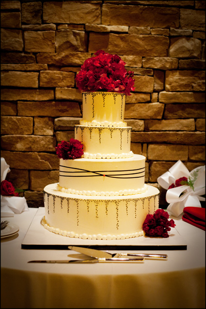 Beautiful wedding cake with red and black accents