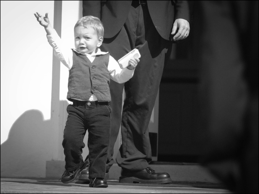 happy baby walks outside after the wedding ceremony