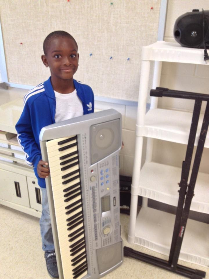 Zaren with donated keyboard.jpg