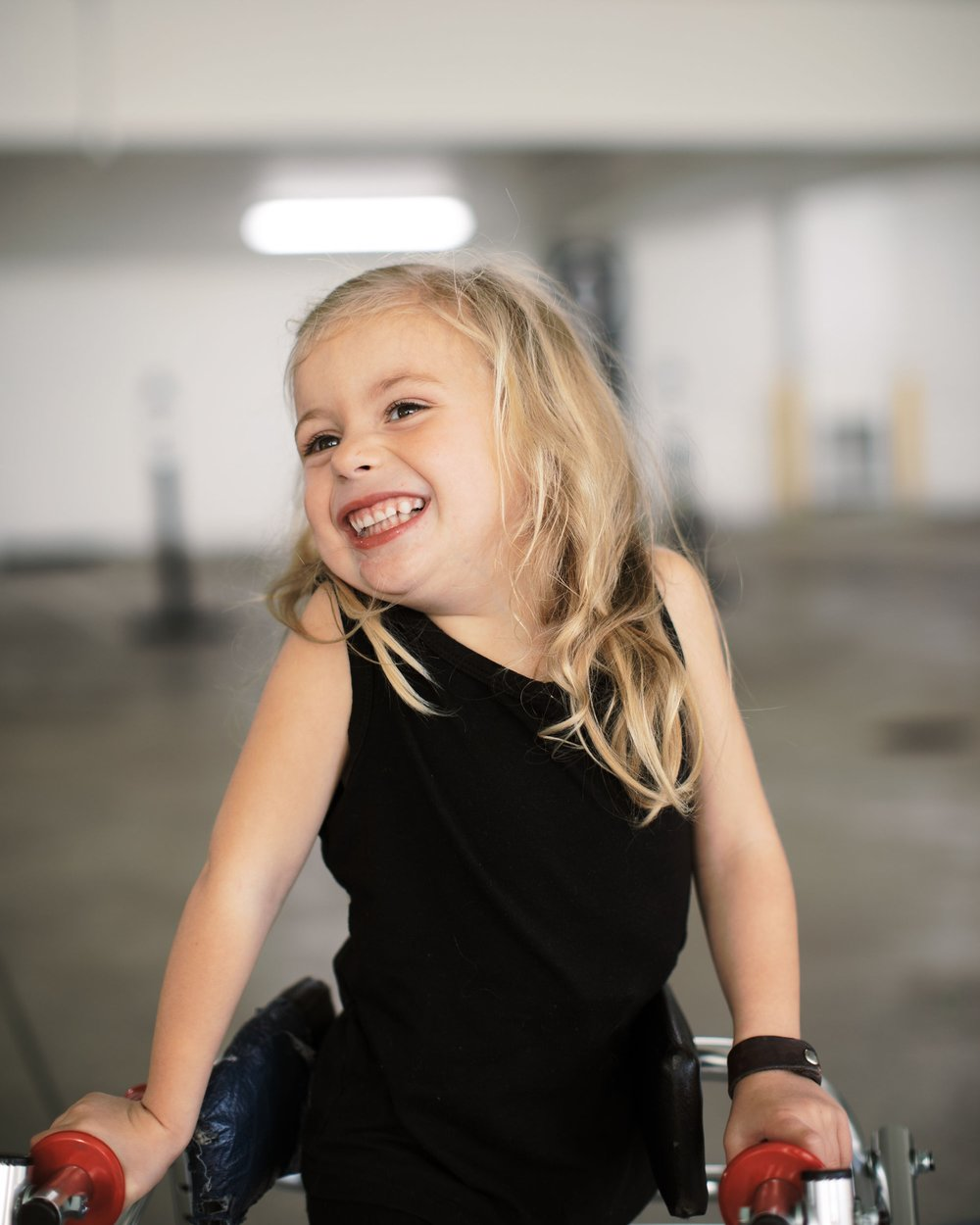 Meet Jaxlee… - With a smile that stops strangers dead in their tracks, Jaxlee Renee is the light of our life! In her four short years she has endured more than most will in a lifetime. At the age of 2, Jaxlee was diagnosed with Cerebral Palsy. She walks with a K-Walker and rides in a wheel chair for long distances. She uses a speech device as well as ASL (American Sign Language) to communicate with us and her peers. She also receives her remaining nutrients and hydration through a g-tube (feeding tube in her tummy) however, these obstacles don't stop her from enjoying every moment of life to the fullest.She has taught us more about the meaning of life than we ever knew existed.Some of her most favorite things include swimming, therapeutic horse back riding and spending time with her family!