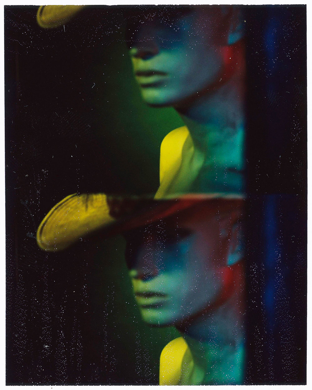 "Jer Nelsen  • Marion, IN   This is a Polaroid of a white window model with a Western hat/feather combo. The Image is shot with a passport camera in the studio. When I think of ""Western"" I think of both consumerist vice and adventure, as well as freedom, so this is a mix of all of those things mashed into one."