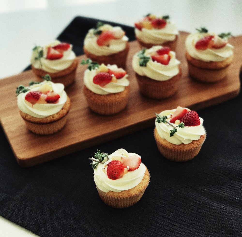 Lemon cupcakes, fresh strawberries with cream cheese frosting by The Good Cake