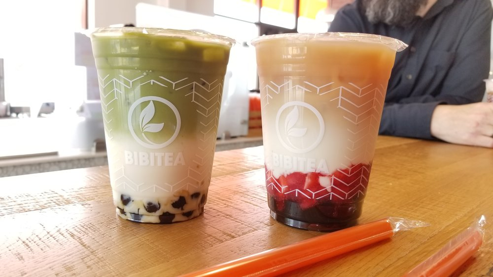 BIBITEA cups, pictured is Matcha and Strawberry Milk before shaking.