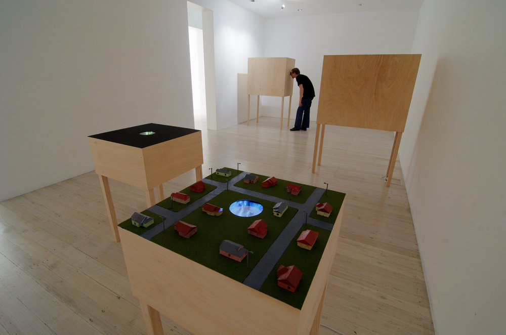 DAVID LAWREY & JAKI MIDDLETON  Wormhole  2011 sculptural diptych: mirrors, timber, polyurethane, paint, polymer clay, copper, LEDs, glue, dimensions variable