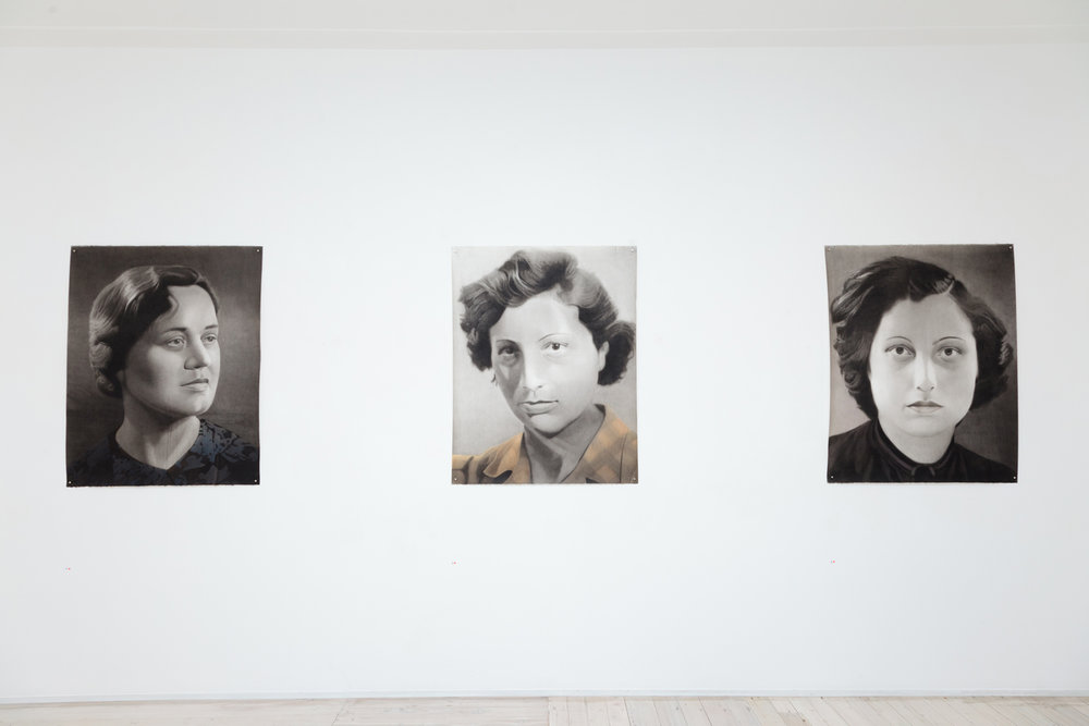 Installation view of Simon Kennedy's portrait paintings