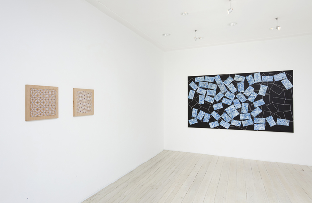 Installation view of Adiran McDonald's paintings