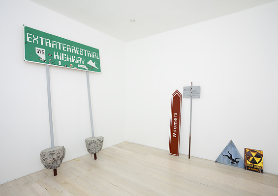 ADAM NORTON  Signs  2010 acrylic on board, PVC pipe, wooden poles, expandable foam dimensions variable