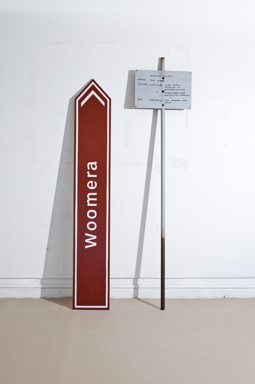 ADAM NORTON  Woomera & Warning Lights  2010 acrylic on board,pole bolts 200 ×100 cm