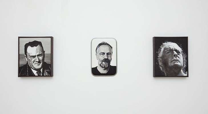 Installation view of Adam Norton's portrait paintings