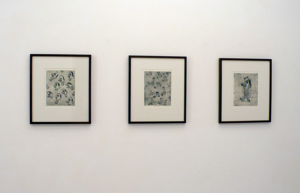 Installation view of Matthew Hopkins's framed etchings