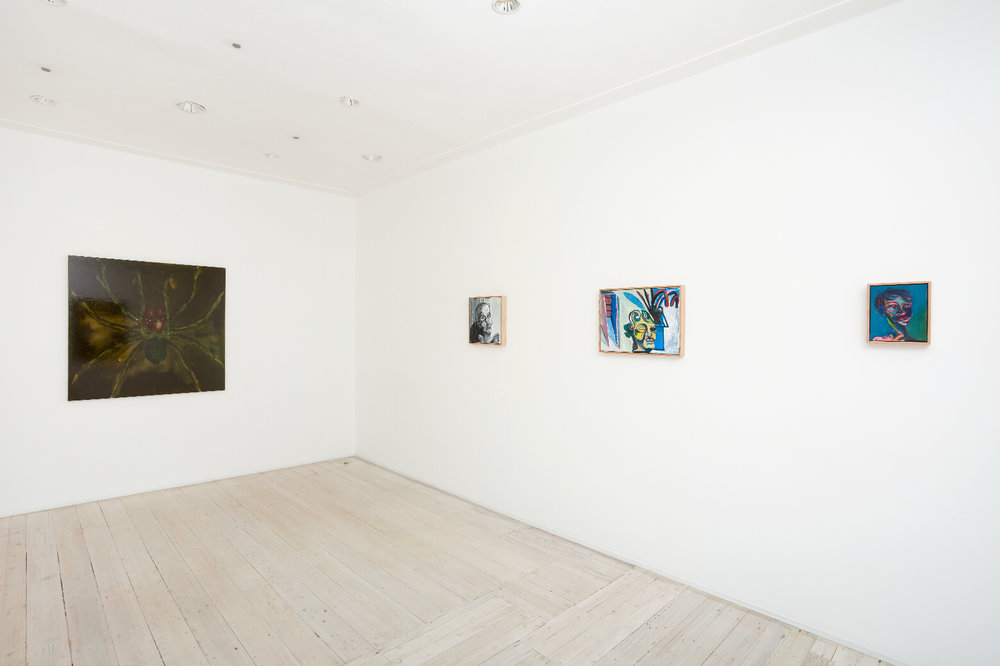 Installation view of WHAT's (left) and Bradd Westmoreland's (right) paintings