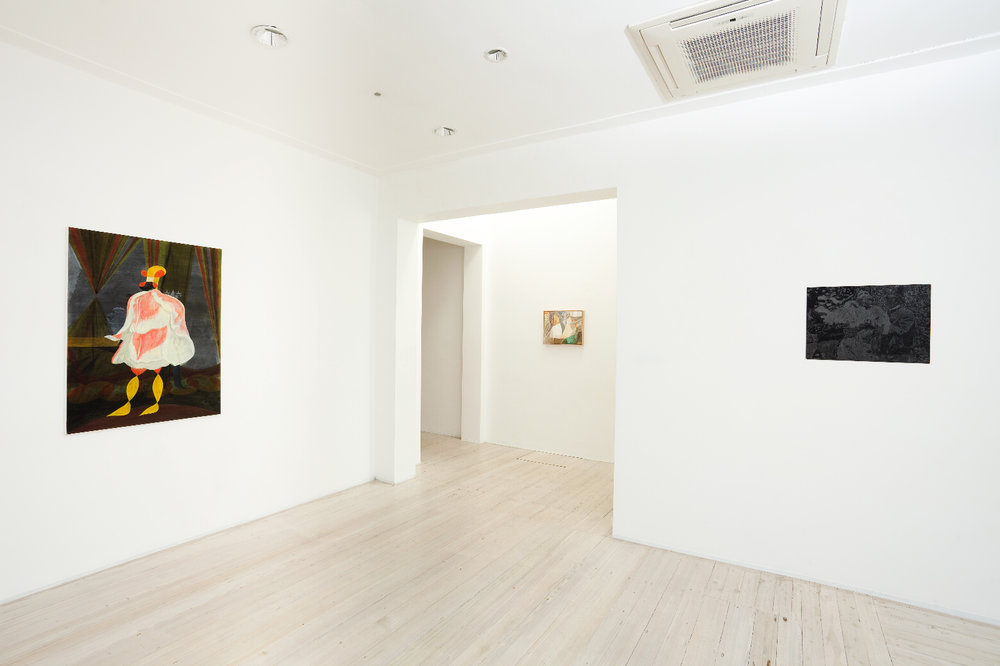 Installation view of group show's paintings