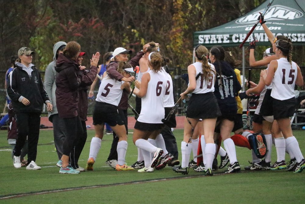 Coach Ryan celebrates with her team winning her last state championship.