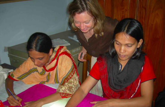 Sophie training Bangladeshi women as part of The Bangladeshi Embroidery Project.
