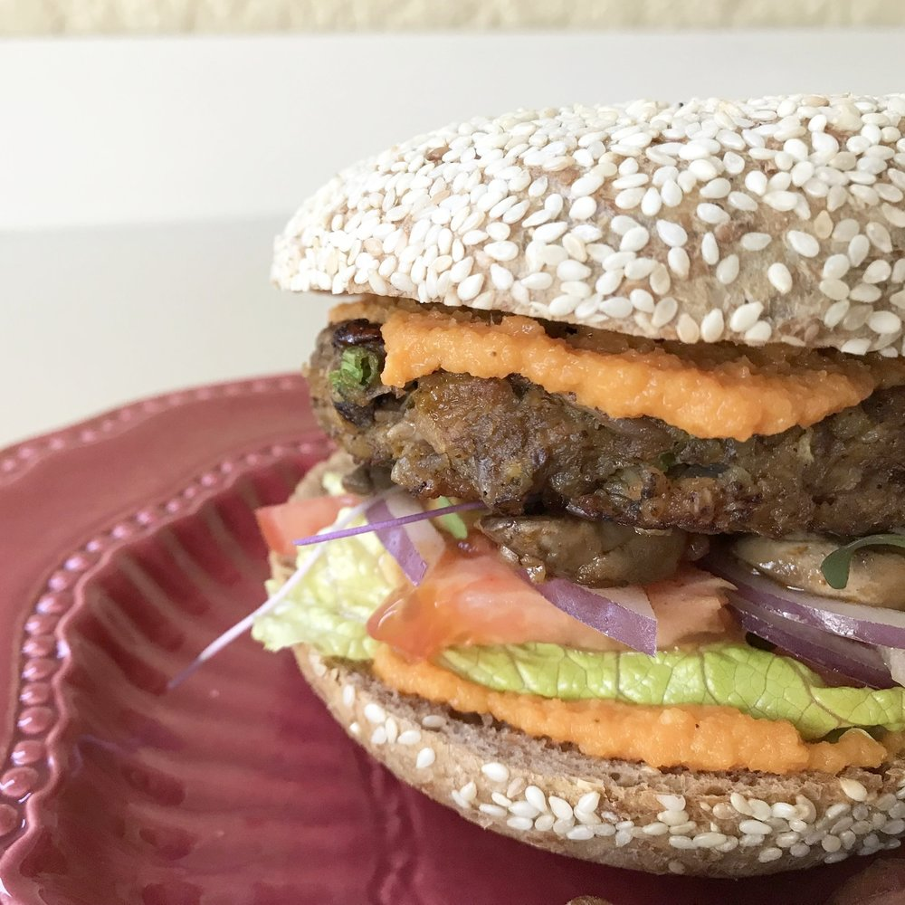 LENTIL VEGGIE BURGER WITH SPROUTED GRAINS BREAD.