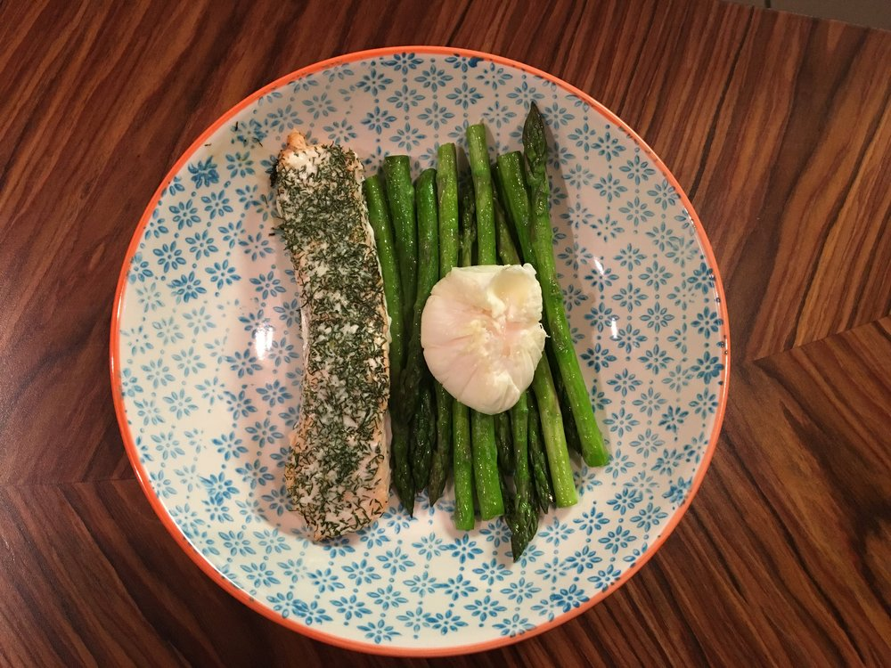 Salmon fillet cooked in the oven with a sprinkle of dill, good ol' asparagus again and a poached egg...because nothing beats an egg! Again, this is so quick but really fresh and healthy.