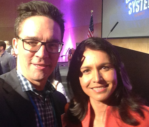 - Sander Hicks with Rep. Tulsi Gabbard (D-HI) at Unrig the System Summit, New Orleans, LA, February 2018.