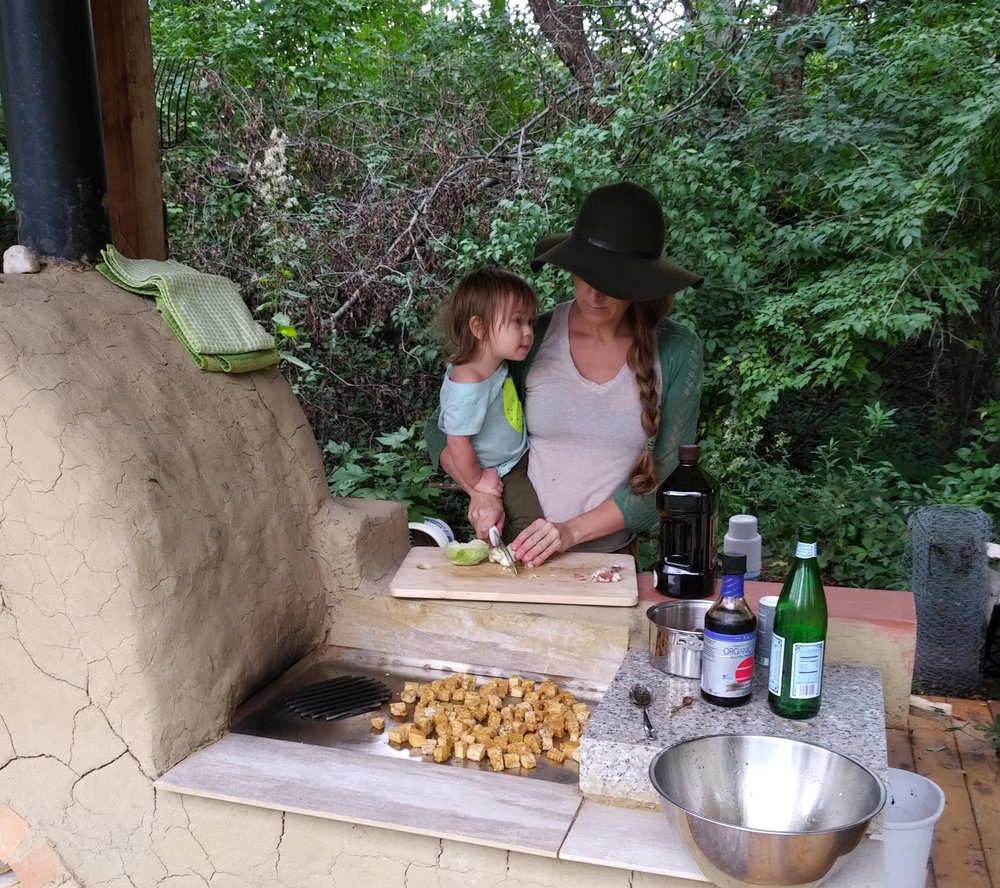 Elliana and I cooking a meal for our farm volunteers.