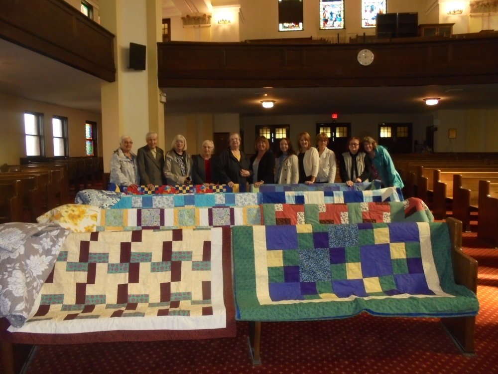 UCW with quilts made for tenants at Cochrane Centre