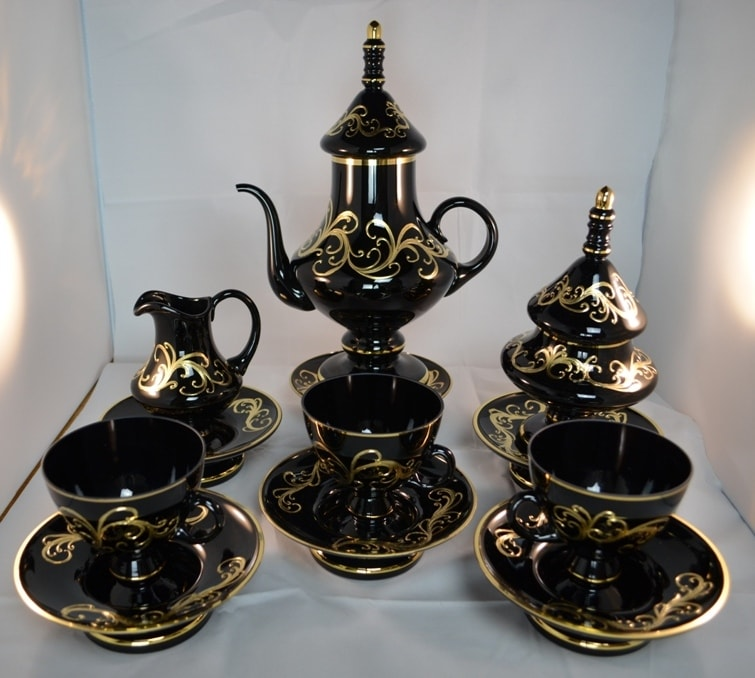 Decorative set of 6 cups with saucers, tea-pot, sugar basin and milk basin