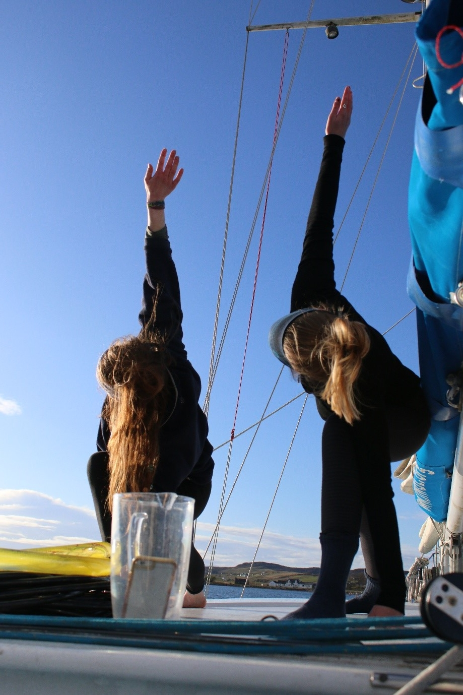 A yoga session on the top deck of Silurian.An attempt to burn off all of the yummy cakes that had been made on board!