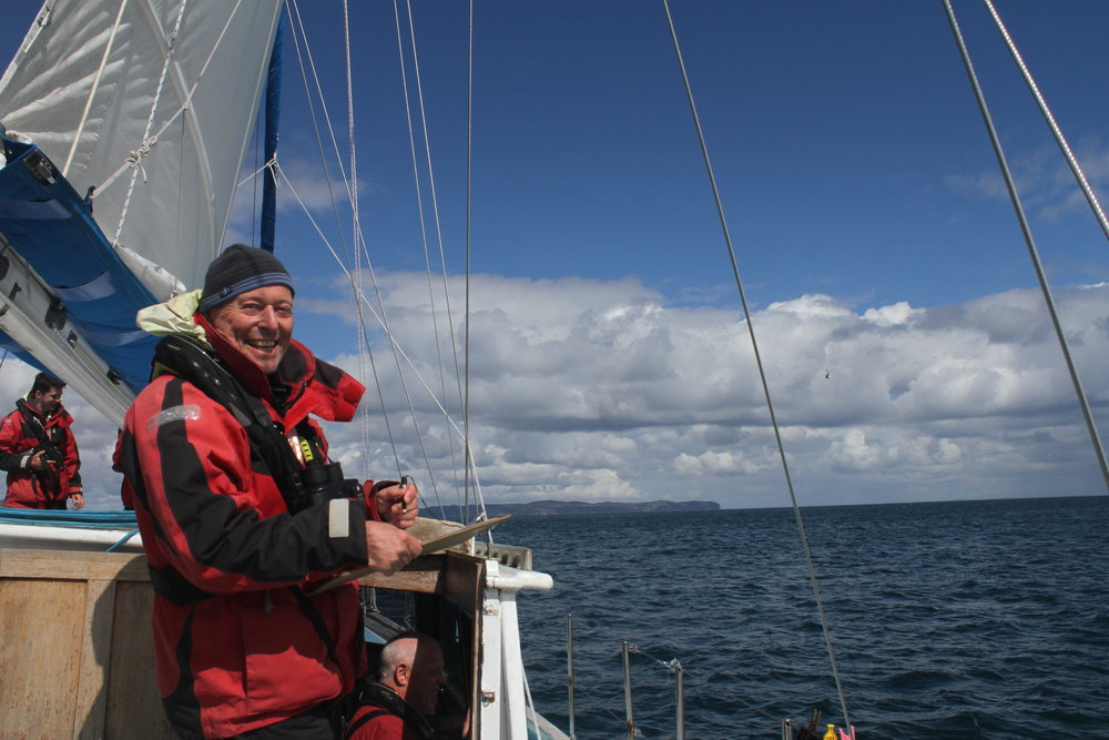 Rod White, one of our dedicated volunteers, monitoring birds on board Silurian.