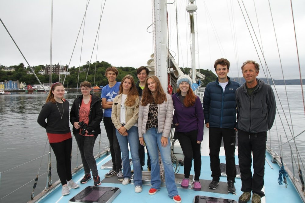 The team whilst on our mooring in Tobermory Bay (minus Simon who is taking the photo!)