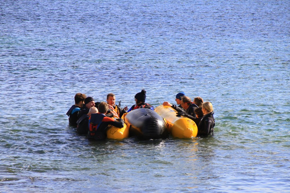Trainee marine mammal medics learn how to re-float a stranded pilot whale (life sized water filled model). Photo courtesy of Stephanie Cope - Tiree Ranger