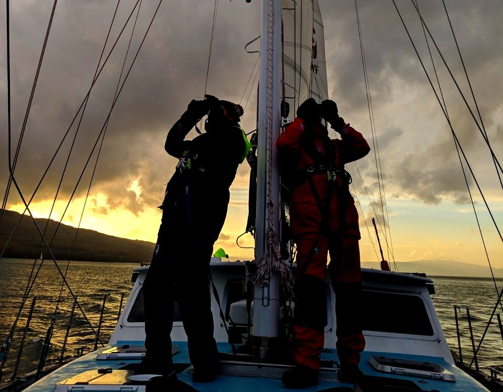 Rob and Steve searching for cetaceans at sunset