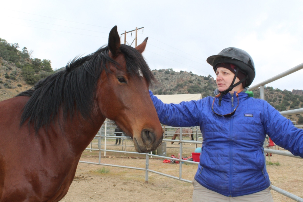 "One of our veterans, Genee, with a wild mustang at Lifesavers Wild Horse Sanctuary. This was during the ""Wild Horse Warriors"" retreat sponsored by EET and  Lifesavers  with a group of 6 female veterans and 6 wild mustangs."