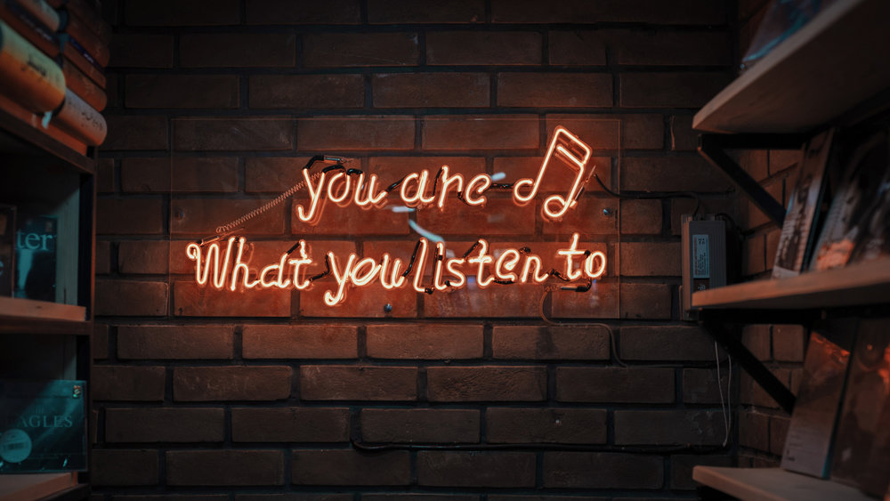 you are what you listen to neon sign unsplash