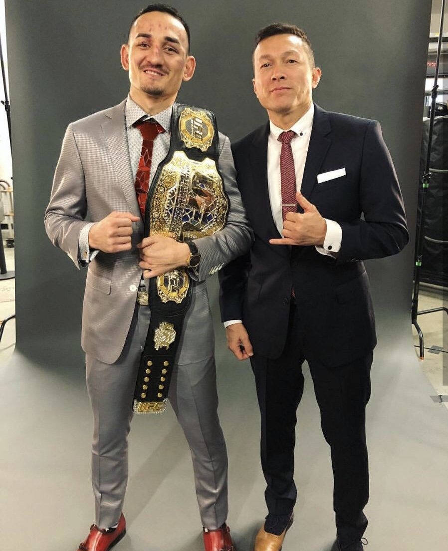 Max Holloway, wearing his one-of-a-kind Sixofour Life watch with his manager, Brian Butler-Au.
