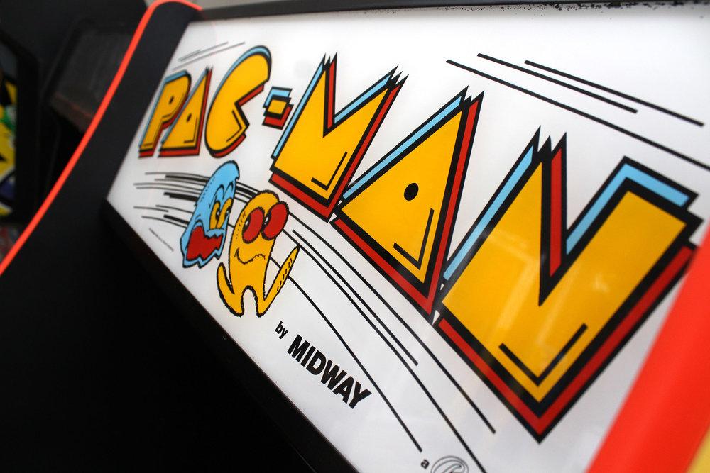 Pac-Man with big floppy clown feet. Lovely art, but weird to see.