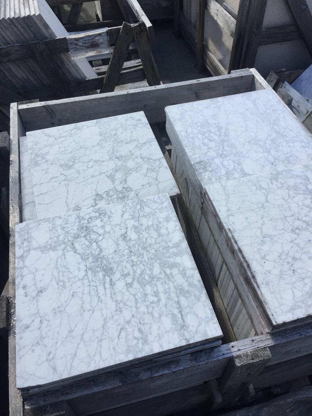 400x400x12mm honed carrara tiles @ €50/sqm