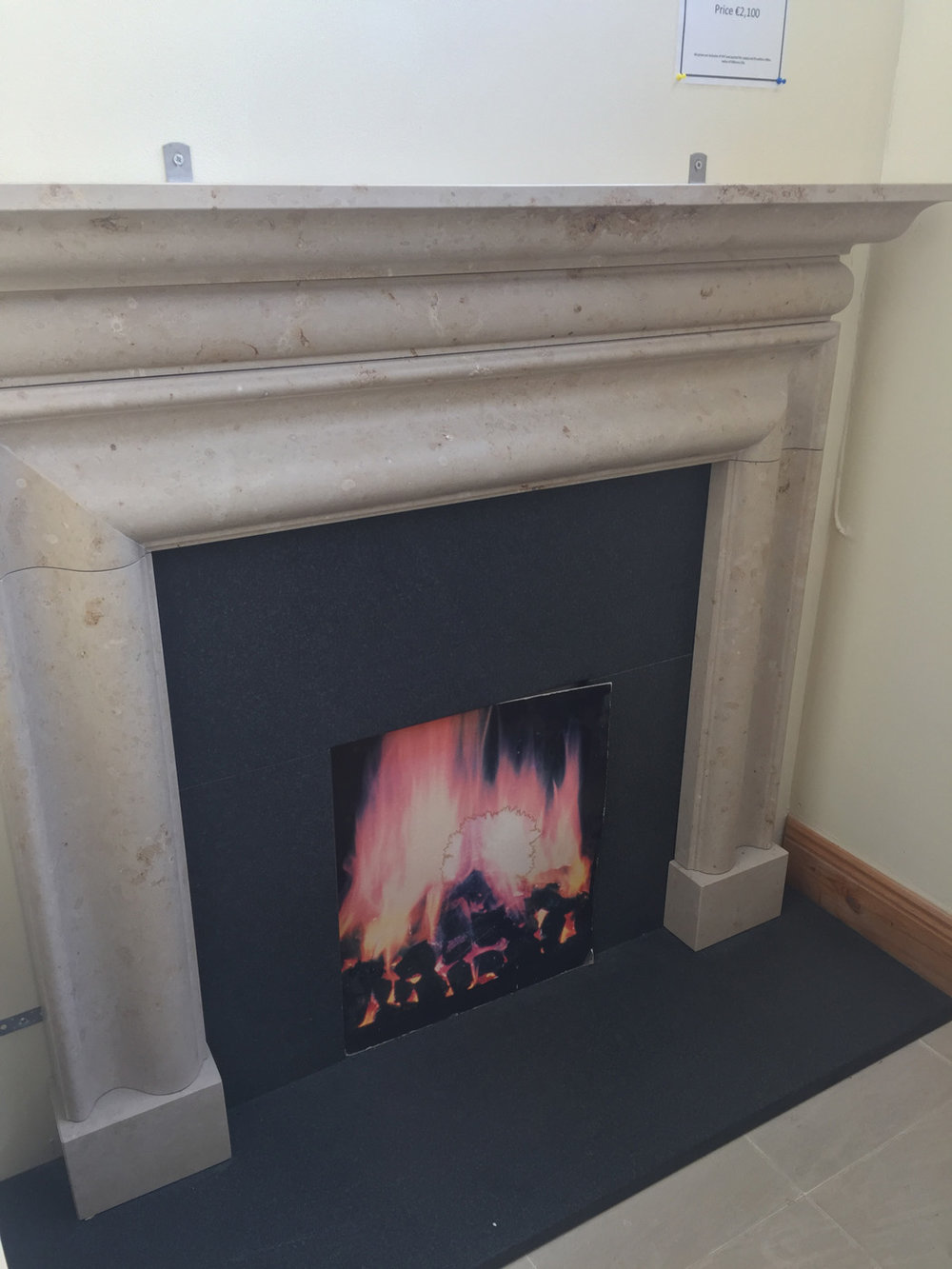 "Jura Bolection. Surround in Jura limestone 5'x52"", insert and hearth in leathered granite - €1,700"