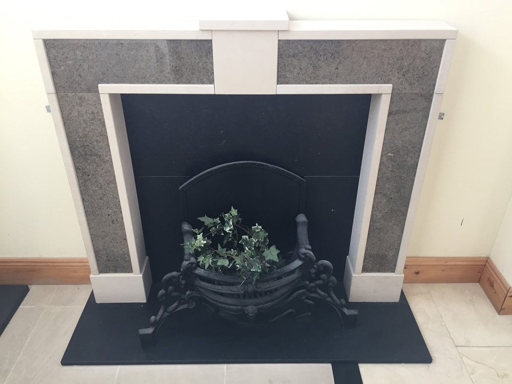 Fireplace with hearth and insert in honed Irish limestone and surround in Portland and Purbeck limestone. One of our own creations - €1,200