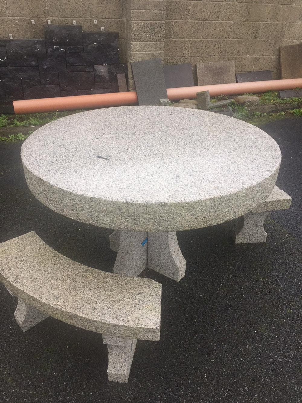 1200 diameter grey granite table with two granite seats - €550