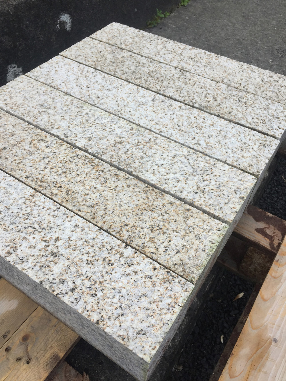 138 linear metres 100x100 Portuguese granite with 1 bushhammered face in lengths of 900, 750, 600 & 500 - €1,400. This could be used for kerbing or cladding