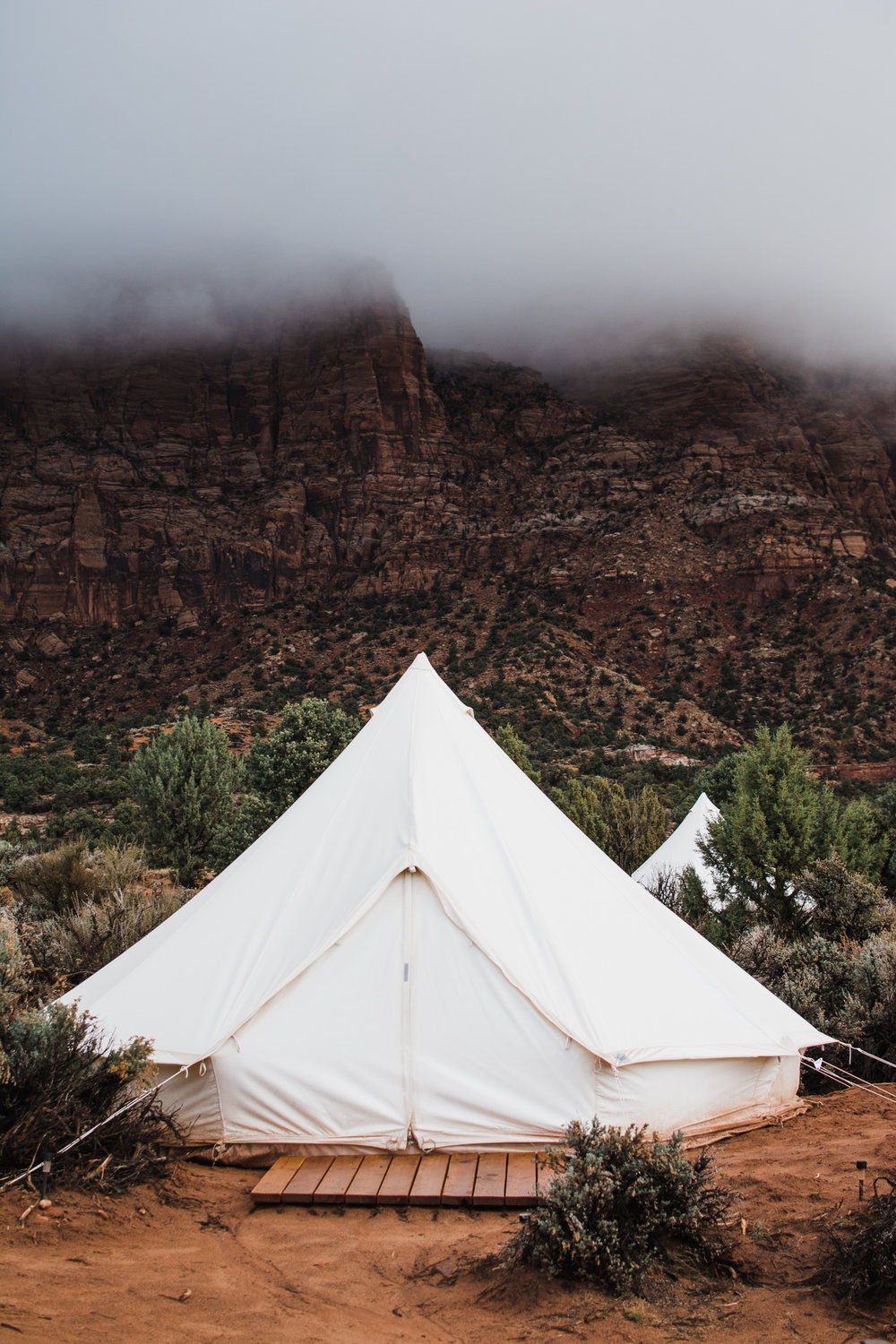 The fog had rested over the red cliffs behind our tent after the thunderstorm during the night.