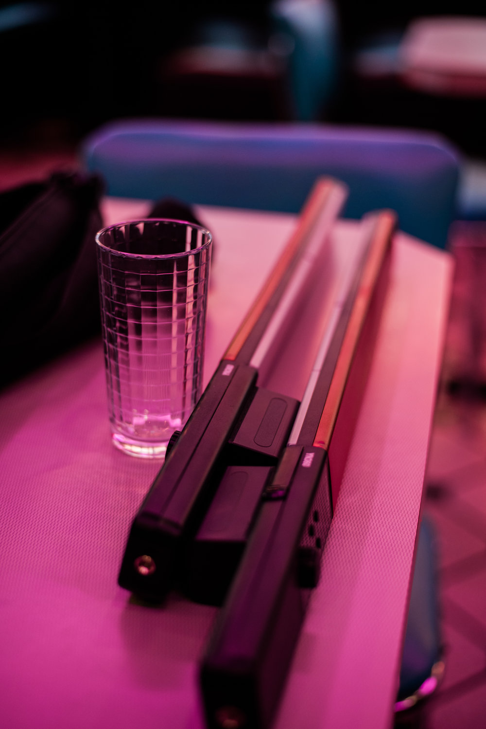 A look at my tools: A cup from the Youth Ranch for refracting the light, and two Yongnuo YN360 LED Light Wand. A lot of the pink light was coming from the neon lights in the diner, but we added a little more blue using the wands.