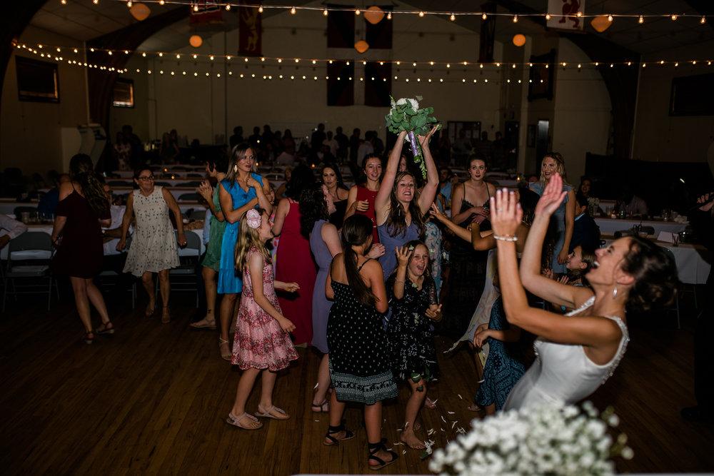 Boise Wedding Photographer // Idaho engagement photographer // PNW Engagement // Wedding // Idaho bride // Natural Couples Posing Ideas // reception photography // bouquet toss // air force wedding // elegant wedding dress // open back wedding dress // boise basque center // catholic wedding // traditional wedding // church wedding // party reception // wedding reception dancing // simple wedding ideas // inn at 500 boise // boise couples photographer // SS Photography & Design // Sadie Shirts
