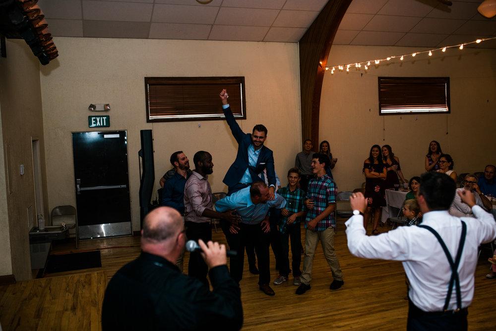 Boise Wedding Photographer // Idaho engagement photographer // PNW Engagement // Wedding // Idaho bride // Natural Couples Posing Ideas // air force wedding // elegant wedding dress // open back wedding dress // boise basque center // catholic wedding // traditional wedding // church wedding // party reception // wedding reception dancing // simple wedding ideas // large group posing // getting ready wedding // inn at 500 boise // boise couples photographer // SS Photography & Design // Sadie Shirts